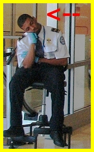 TSA agent daydreaming about his future union representation. (Photo credit: TheeErin)
